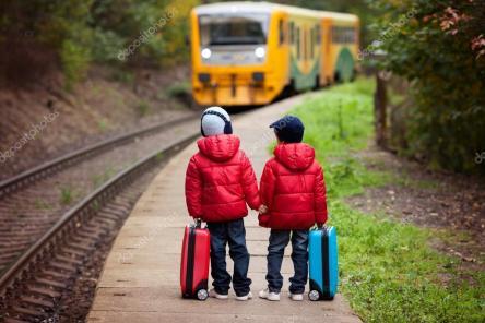 depositphotos_85795966-stock-photo-two-boys-on-a-railway
